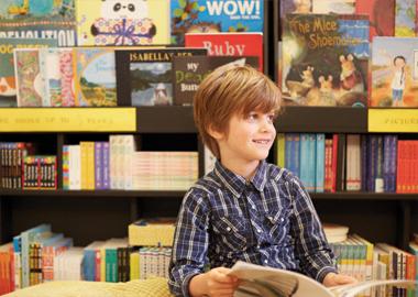 Young boy ready a book