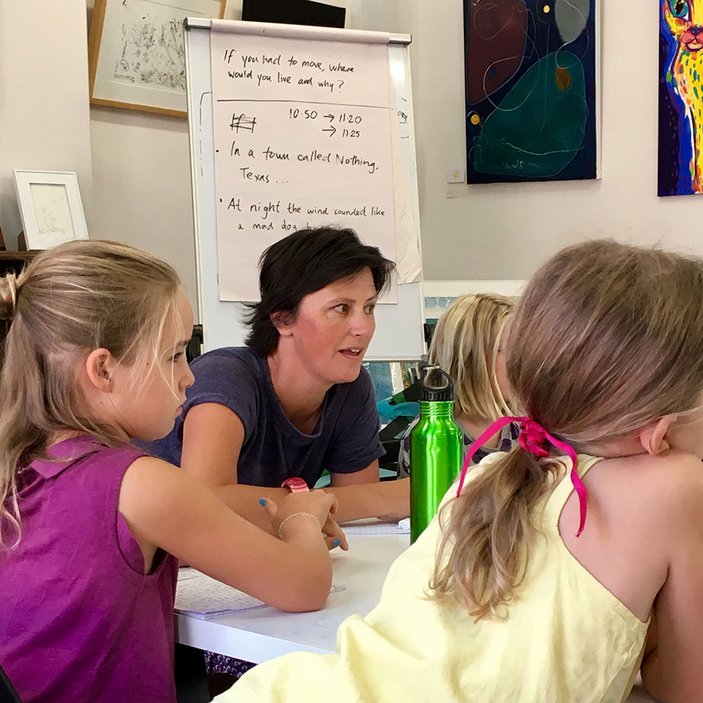 Woman workshopping stories with children