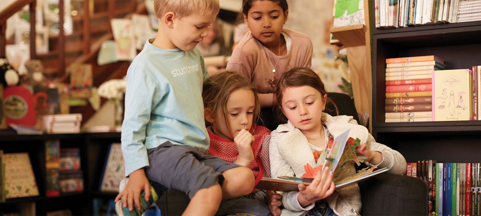 Kids gathered around a book reading