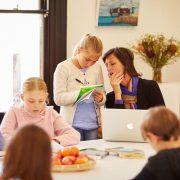 Teacher observing a child's work